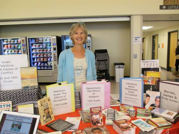 Linda Bevis peddling the Palestine Teaching Trunk at last year's NW Conference on Teaching for Social Justice. Photo: Palestine Information